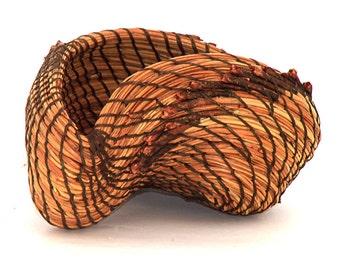 The  Swirl.  A free form pine needle basket, sculpture fiber art basket