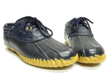 navy blue rain shoes . perfect for spring weather . by Sporto . womens size 5 . heavy, chunky and clunky duck shoes
