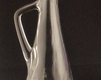 BOTTLE Molded GLASS  signed Beveled Faceted Clear with cork stopper app 15 in tall 4 1/2 in long by 3 3/4 wide