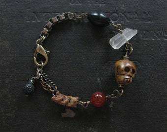Grimly No. 3 - Grumpy Carved Bone Skull With Stones and Antique Rosary Beads Bracelet