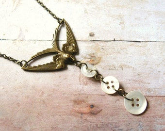The Button Thief - Art Deco Style Swallow Bird Pendant Necklace with Vintage Shell Buttons