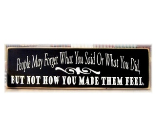 People may forget what you said or what you did but not how you made them feel wood sign