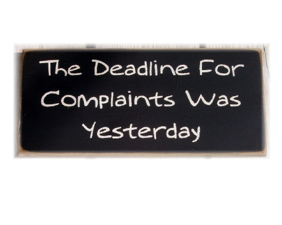 The deadline for complaints was yesterday primitive wood sign