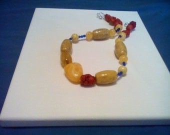 Sunshine yellow and red beaded necklace.