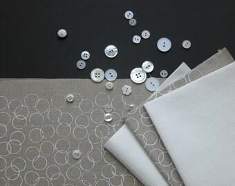 white circles - hand screen printed onto natural linen / cotton