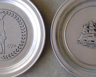 Two signed Wilton metal Patriotic plates - patriotic and ship