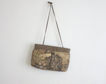 VACATION SALE. tableau tapestry clutch
