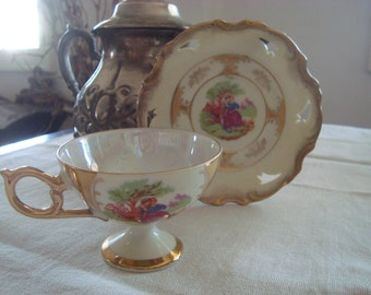 Vintage Pedestal Cameo Style Luster with Gold Teacup & Saucer
