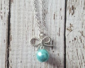 The Carrie Necklace...a pretty silver bow w/ an Aqua Blue pearl, more colors available, child/adult size, Buy 3 or more for 10% OFF