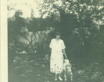 1920s Flapper Woman and Dog Standing Outside Short Bob Hair Vintage Black and White Photo Photograph