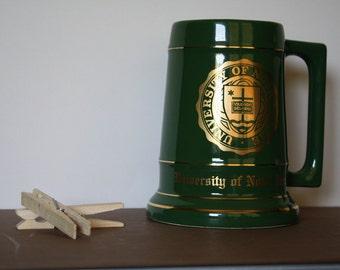 UNIVERSITY of NOTRE DAME - Green ceramic stein, gold trim/lettering