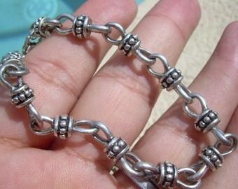 Unique link bracelet Vintage silver tone unique find.  No markings that I can see, Bali style.