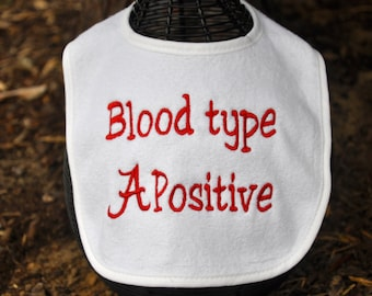 "Alabama EMBROIDERED BABY BIB with the phrase ""Blood type A positive"""