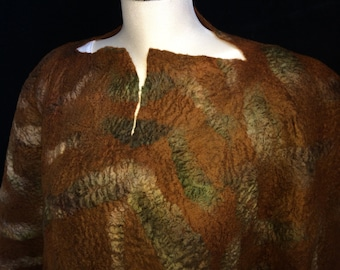 This is a hand made wet felted merino wool poncho. It is mahogony colored with greens and tans in the patterning. It measures 58 by 48 ""