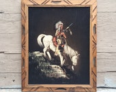 1960's black velvet painting of Native American chief on white horse, kitschy black velvet Western art, Indian and cowboy art
