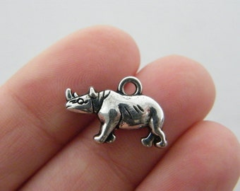 4 Rhino charms antique silver tone A12
