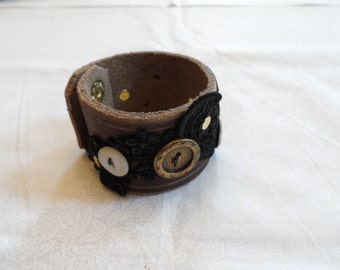 Leather and Lace Wrist Band - 7 inches - buttons, gears, rivets, snaps