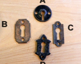 antique cast iron and stamped steel architectural key hole escutcheons