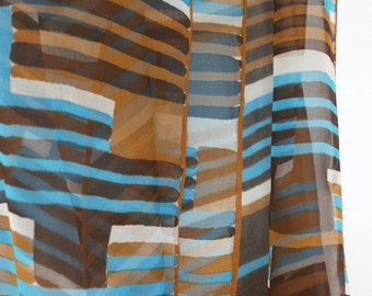 Gorgeous sheer Vera scarf with geometric pattern in aqua, brown, caramel and white. Stripes, color block, oblong, wide, mod, retro.