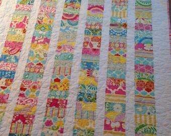 Kumari Garden Coins Crib Quilt Baby Blanket -- pink, green, yellow, blue, red -- Dena Designs fabrics