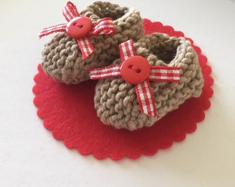 Baby shower cake topper: hand knit light brown mini booties with red/ white gingham bows, red buttons on felt base -DECORATION SIZE