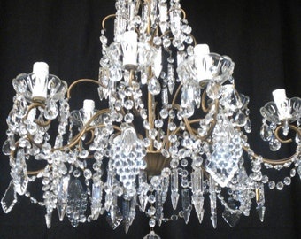 Italian  vintage 9 arms solid brass chandelier with rare-shaped glass crystals