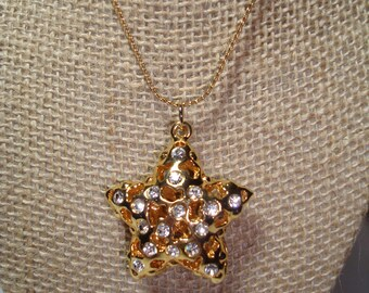 1992 Golden Rhinestone Puffy Star Necklace.