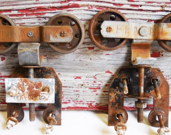 Two vintage barn door rollers Frantz wheels double wheel restoration hardware casters industrial Urban loft rolling door supplies