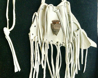 White leather fringed medicine bag necklace with soft white leather and accented with a modern stone arrowhead attached using faux sinew
