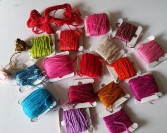 Sixteen Cardboard Rolls of Embroidery Thread