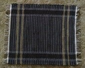 Black rug with brown, handwoven rag rug, recycled