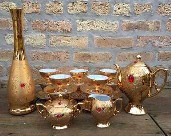 FLORES - BAVARIA - tea set - GOLD with red faux gems - very fancy - 24 piece set - tea pot - vase - cups and saucers - creamer - sugar