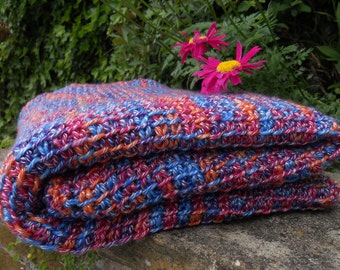 Blanket/afghan/throw hand crafted in Tunisian crochet. Soft and smooth wool/acrylic yarn in blue/pink/orange. Size 63in x 37in