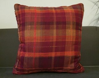Hand woven cushion red orange & yellow