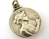 French antique silver plated slide locket Euterpe,
