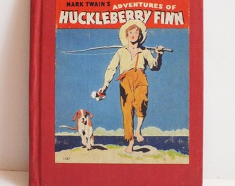 Vintage 1940's Hardback book Mark Twain's Adventures of Huckleberry Finn - Spine is Tight - 96 pages -