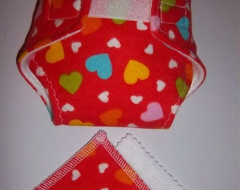 "Baby Doll Diaper/wipes - ""heart"" special, multi color and multi size hearts on orange - adjustable for many dolls such as bitty baby"