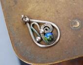 Vintage silver tone metal filigree  pendant. Floral decor