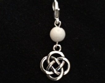 Silver metal Celtic Knot with white coral bead diffuser charm pendant or zipper pull.