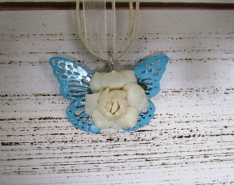White Rose Butterfly Pendant Necklace with White Flower blue filagree butterfly on an off white ribbon necklace