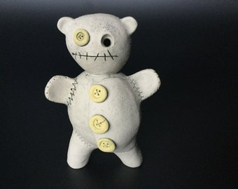 Self-State Ted-  ( not so ) cute ceramic teddy, hand sculpted - hours and hours of loving hands, sits solid in the palm of your hand.