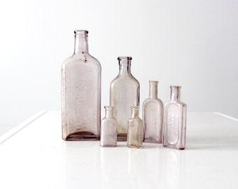 antique apothecary bottle collection, set purple glass bottles