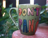 """Douglas Adams """"Don't Panic"""" Literary Quote Mug - The Hitchhiker's Guide to the Galaxy - 42 hand painted coffee mug - Med-Sm olive green"""