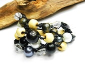 Nature linen bracelet with wood, glass and beads. Layered black string. Black & yellow