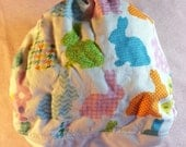 SassyCloth one size pocket diaper with Easter bunnies on white cotton print. Ready to ship.