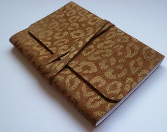 Suede Journal Leather Journal Travel Journal Leather Notebook. Tan Suede with an Animal print embossed in Gold onto the Leather.
