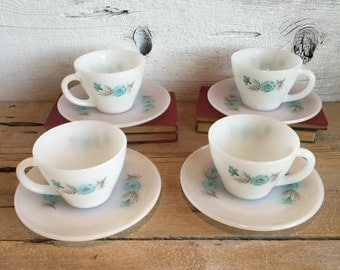 Set of 4 Blue flower Fire King tea cup and saucer.