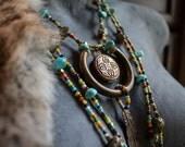 WING & A PRAYER, tribal assemblage necklace, multistrand beaded, prayer locket, vintage bells