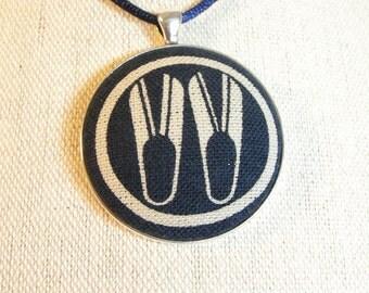 Pendant, Japanese family crest depicting scissors, large round pendant on satin cord, nickel free, ecru on navy