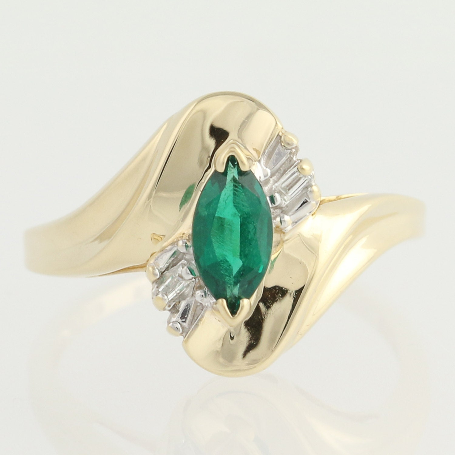 synthetic emerald and bypass ring 10k by